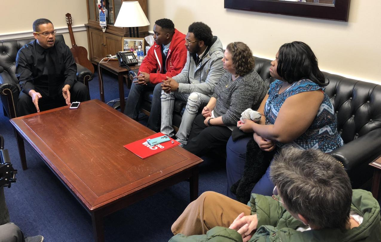 Representative Keith Ellison talking with GDIT workers in his office